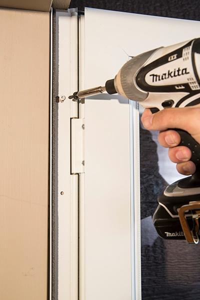 Simple Solutions To Fix A Squeaky Door--hinge rail.jpg