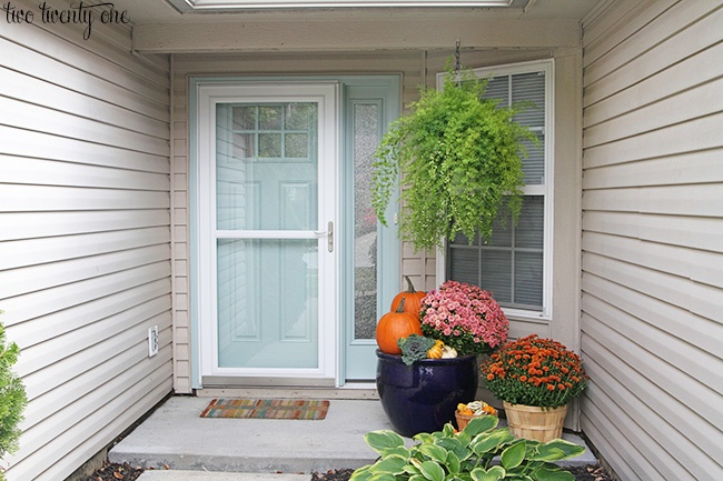 Replace Dated and Worn Door with a New White Storm Door and Aqua Door