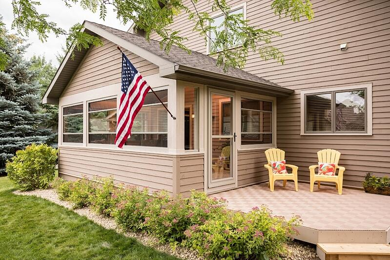 Scenix Porch with Retractable screens with patio and yellow chairs